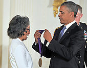 United States President Barack Obama presents the 2012 National Medal of Arts to Joan Myers Brown during a ceremony in the East Room of the White House in Washington, D.C.  on Wednesday, July 10, 2013.<br /> Credit: Ron Sachs / CNP