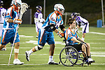 San Francisco Dragons vs Los Angeles Riptide.Lebard Stadium, Orange Coast College,Huntington Beach, California.Anthony Kelly (#34) wheels Cameron Piorek of Aliso Niguel High School onto the field, Piorek is paralyzed from the chest down as a result of a collision during a high school lacrosse game in April 2008.OM3D8510.JPG.CREDIT: Dirk Dewachter