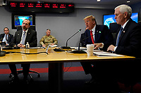 United States President Donald J. Trump, second from right, speaks during a teleconference with governors at the Federal Emergency Management Agency headquarters, Thursday, March 19, 2020, in Washington, DC. US Vice President Mike Pence is at right and US Secretary of Health and Human Services (HHS) Alex Azar, at left.<br /> Credit: Evan Vucci / Pool via CNP/AdMedia