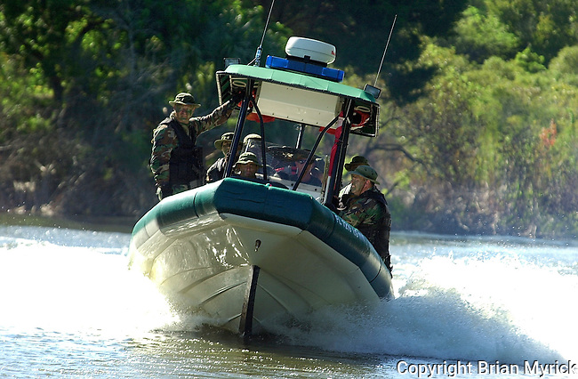 Members of the Flagler County Sheriff's Office Emergency Response Team ride aboard one of the departments marine units during training.(Brian Myrick)