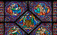 Medieval stained glass Window of the Gothic Cathedral of Chartres, France - dedicated to the Life and Miracles of St Nicholas. Replaced panels. A UNESCO World Heritage Site.