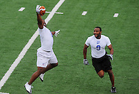 Jun. 13, 2009; Las Vegas, NV, USA; Tyronne Gross makes a one handed catch under pressure from Marviel Underwood during the United Football League workout at Sam Boyd Stadium. Mandatory Credit: Mark J. Rebilas-