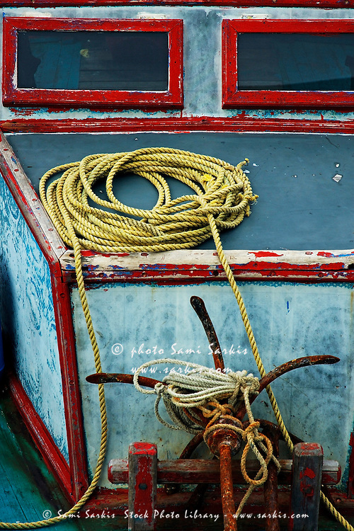 Ropes and rusty anchors on a boat deck, Male, Maldives.