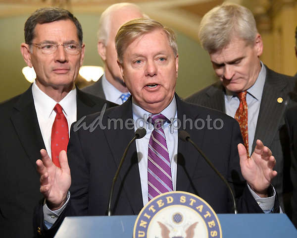 United States Senator Lindsey Graham (Republican of South Carolina) speaks to reporters outside the US Senate Chamber following the Republican weekly luncheon caucus in the US Capitol in Washington, DC on Tuesday, September 19, 2017.  The GOP leadership is advocating for the passage of the Graham-Cassidy Act that would replace parts of the Affordable Care Act (also known as ObamaCare) with block grants for the individual states.  From left to right: US Senator John Barrasso (Republican of Wyoming), Senator Graham and US Senator Bill Cassidy (Republican of Louisiana). Photo Credit: Ron Sachs/CNP/AdMedia