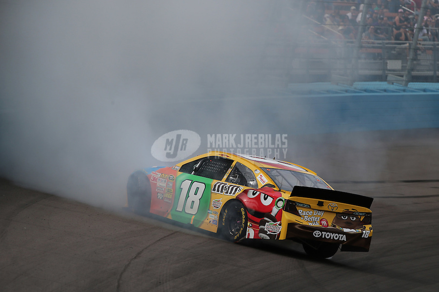 Mar. 3, 2013; Avondale, AZ, USA; NASCAR Sprint Cup Series driver Kyle Busch spins during the Subway Fresh Fit 500 at Phoenix International Raceway. Mandatory Credit: Mark J. Rebilas-