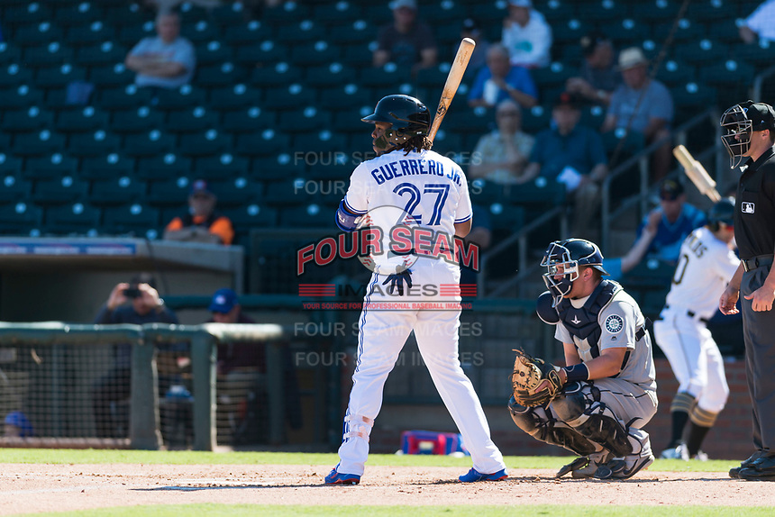 Surprise Saguaros designated hitter Vladimir Guerrero Jr. (27), of the Toronto Blue Jays organization, at bat in front of catcher Joe DeCarlo (4) and home plate umpire Brennan Miller during an Arizona Fall League game against the Peoria Javelinas at Surprise Stadium on October 17, 2018 in Surprise, Arizona. (Zachary Lucy/Four Seam Images)