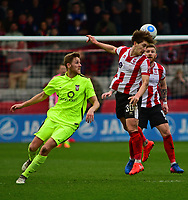 Lincoln City's Alex Woodyard vies for possession with York City's Asa Hall<br /> <br /> Photographer Andrew Vaughan/CameraSport<br /> <br /> Buildbase FA Trophy Semi Final Second Leg - Lincoln City v York City - Saturday 18th March 2017 - Sincil Bank - Lincoln<br />  <br /> World Copyright &copy; 2017 CameraSport. All rights reserved. 43 Linden Ave. Countesthorpe. Leicester. England. LE8 5PG - Tel: +44 (0) 116 277 4147 - admin@camerasport.com - www.camerasport.com