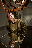 "Alexander Lavrentiev (Lavrentyev), grandson of renowed Russian constructivist artist Alexander Rodchenko, poses for portrait by the ""Three-Dimension Construction number 10"" of the series ""Light Reflecting Planes"" at Rodchenko's exhibition in Moscow. Picture by Justin Jin."