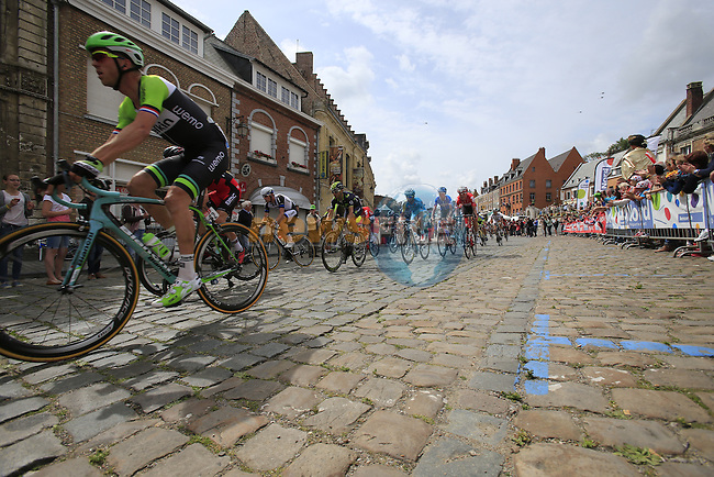 The peleton including Lars Boom (NED) Belkin pass through the ancient town of Cassel during Stage 4 of the 2014 Tour de France running 163.5km from Le Touquet to Lille. 8th July 2014.<br /> Picture: Eoin Clarke www.newsfile.ie