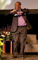 NWA Democrat-Gazette/DAVID GOTTSCHALK   John L. Colbert, associate superintendent for Support Services at Fayetteville Public Schools, dances on stage Friday, August 11, 2017, prior to opening remarks for the Imagine the Possibilities Fayetteville Public Schools Convocation 2017 inside the high school arena on the campus. The convocation included performances with the high school band, keynote speaker Matthew Wendt, superintendent of schools followed by the 30th annual Fayetteville Education Expo.