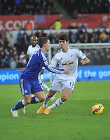 SWANSEA, WALES - JANUARY 17:   of  during the Barclays Premier League match between Swansea City and Chelsea at Liberty Stadium on January 17, 2015 in Swansea, Wales. Swansea's Nelson Oliviera chasing down possession