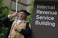 May 21, 2013  (Washington, DC)  A member of the Tea Party protests in front of the Internal Revenue Service headquarters in the District of Columbia. The protest was part of a national Tea Party effort May 21, 2013 against IRS abuses of conservative groups.   (Photo by Don Baxter/Media Images International)