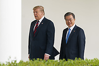US President Donald J. Trump (L) and Korean President Moon Jae-in (R) walk along the Colonnade of the White House in Washington, DC, USA, 11 April 2019. President Moon is expected to ask President Trump to reduce sanctions on North Korea in an attempt to jump start nuclear negotiations between North Korea and the US.<br /> CAP/MPI/RS<br /> ©RS/MPI/Capital Pictures