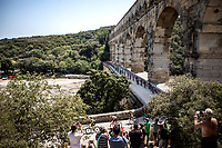 Peloton rolling over the pittoresque 'Pont du Gard' <br /> <br /> Stage 16: Nimes to Nimes (177km)<br /> 106th Tour de France 2019 (2.UWT)<br /> <br /> ©kramon