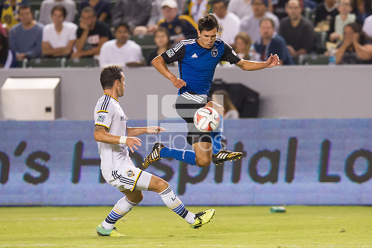CARSON, CA - August 8, 2014: San Jose Earthquake midfielder Shea Salinas (6) receives a pass during the LA Galaxy vs San Jose Earthquakes match at the StubHub Center in Carson, California. Final score, LA Galaxy 2, San Jose Earthquakes 2.