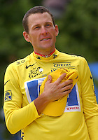 27.07.2003 US Postal-Berry Floor's Lance Armstrong from the US, wearing the overall leader's yellow jersey, holds his hand to his heart as he poses on the podium after the 20th stage of the 2003 Tour de France cycling race, in Paris, 27 July 2003. Armstrong became the second rider in history to win the Tour de France on five consecutive occasions tying the record of Spain's Miguel Indurain, who won from 1991 to 1995.