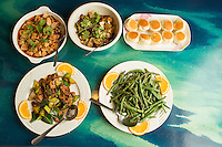 Clockwise from top left: Stir-fried Tofu in Szechuan Sauce, the Hot-spicy Pot, The Pan-fried Bun stuffed with Pork, Sauteed String Bean with Garlic Sauce and the Double Sauteed Pork and Leeks in Szechuan Sauce at Dim Sum House in Morrisville, N.C. on Saturday, March 29, 2014. (Justin Cook)