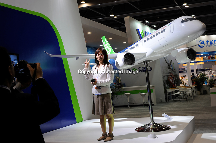 The Comac C919  at Asian Aerospace 2011 (Asian Aerospace International Expo and Congress) held in Hong Kong's Asia World Expo, Hong Kong, China, is to be built by the Commercial Aircraft Corporation of China (Comac). COMAC is planning to take on established players such as Boeing and Airbus as it targets the global aircraft market. Asian Aerospace is the world's largest single-focused exhibition and congress for the commercial aerospace and civil aviation market with particular emphasis on the Asia-Pacific region. This year a record of 270 exhibitors from 32 countries, and the number of Chinese companies increased by 42% comparing to last year..09 Mar 2011