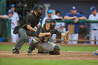 Nate Nolan (18) of the Great Falls Voyagers on defense against the Ogden Raptors at Lindquist Field on August 16, 2017 in Ogden, Utah. Home plate umpire Edgar Morales handles the calls. The Voyagers defeated the Raptors 11-6. (Stephen Smith/Four Seam Images)