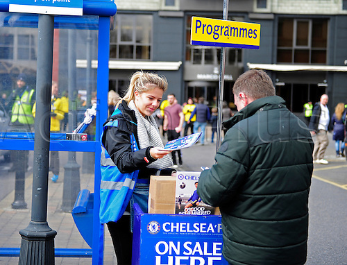 21.02.2016. Stamford Bridge, London, England. Emirates FA Cup 5th Round. Chelsea versus Manchester City. Programme seller finds her man