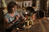 France, Aquitaine, Pyrénées-Atlantiques, Pays Basque, Itxassou: Mirentxu Elissalde, Ferme Antxondoa, déguste son Fromage  Ardi gasna, AOC Ossau-Iraty avec sa  Confiture de cerises  d'Itxassou  //  France, Pyrenees Atlantiques, Basque Country, Itxassou: Mirentxu Elissalde, Ferme Antxondoa, tasting  her ewe cheese  Ardi gasna, AOC Ossau-Iraty with her Itxassou Cherry Jam