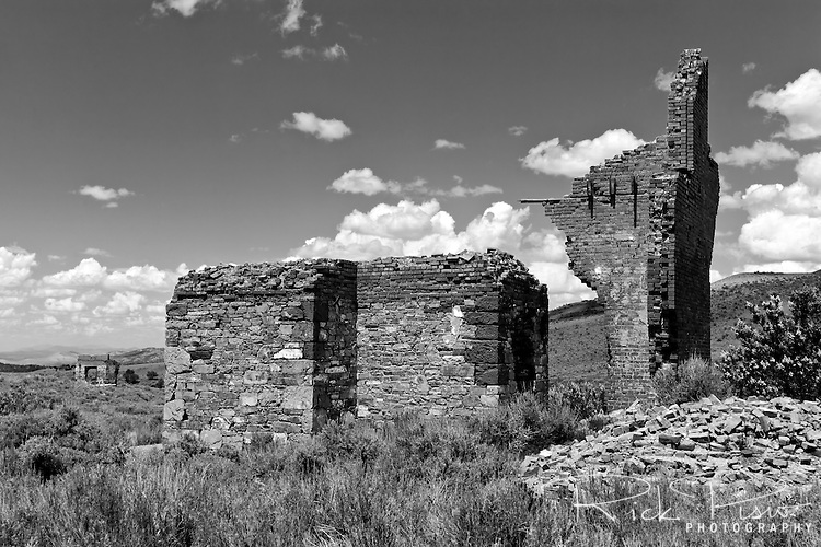 The remains of the Whitington Hotel in Hamilton, Nevada. In 1868 Hamilton started as a boomtown with 25,000 people migrating to the area where silver ore was for the taking. The town was the first county seat of White Pine County, from 1869 to 1887, when a fire led to its replacement by the town of Ely. In 1887 big-scale production ceased and the population left just as quickly as they had come. Today the town is abandoned with only the facades from a few of the buildings remaining
