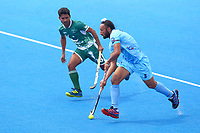 India's Sardar Singh is shadowed by Pakistan's Muhammad Dilber during the Hockey World League Semi-Final match between Pakistan and India at the Olympic Park, London, England on 18 June 2017. Photo by Steve McCarthy.
