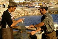 Fishermen in Algarve, Portugal