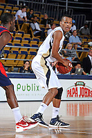 25 February 2012:  FIU guard DeJuan Wright (14) handles the ball in the second half as the FIU Golden Panthers defeated the University of South Alabama Jaguars, 81-74, at the U.S. Century Bank Arena in Miami, Florida.