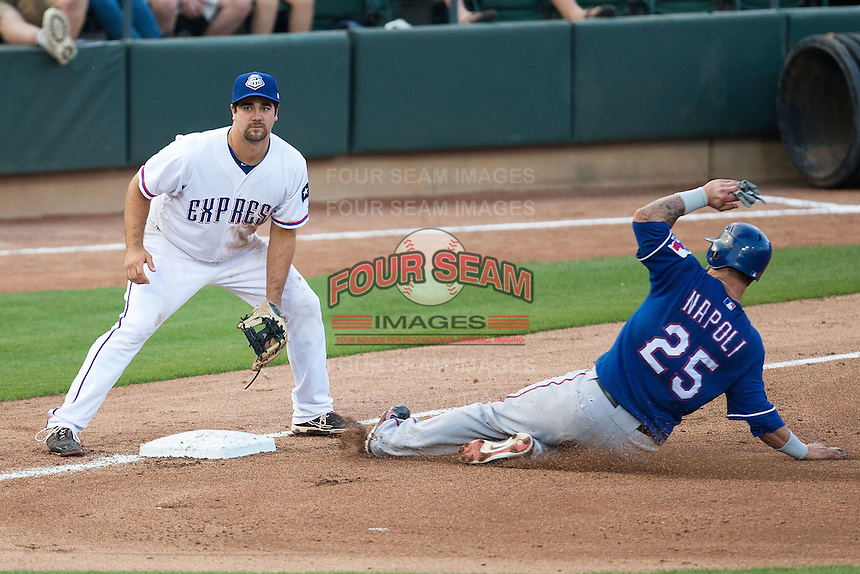 Round Rock Express third baseman Tommy Mendonca #24 at third while Rangers Mike Napoli #25 slides safely during the MLB exhibition baseball game against the Texas Rangers on April 2, 2012 at the Dell Diamond in Round Rock, Texas. The Rangers out-slugged the Express 10-8. (Andrew Woolley / Four Seam Images).