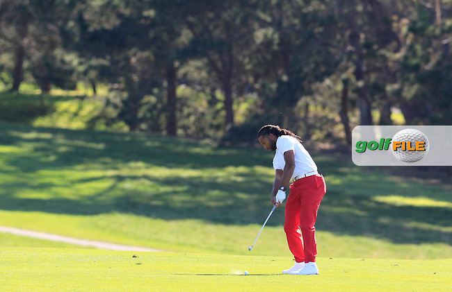 Arizona Cardinals NFL wide receiver Larry Fitzgerald plays his 2nd shot on the 13th hole at Pebble Beach Golf Links during Sunday's Final Round 4 of the 2017 AT&amp;T Pebble Beach Pro-Am held over 3 courses, Pebble Beach, Spyglass Hill and Monterey Penninsula Country Club, Monterey, California, USA. 12th February 2017.<br /> Picture: Eoin Clarke | Golffile<br /> <br /> <br /> All photos usage must carry mandatory copyright credit (&copy; Golffile | Eoin Clarke)