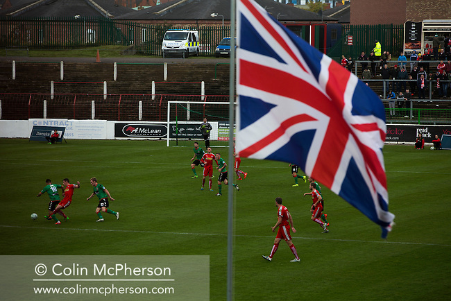 A Union flag dominated the view at The Oval, Belfast as Glentoran (in green) host city-rivals Cliftonville in an NIFL Premiership match. Glentoran, formed in 1892, have been based at The Oval since their formation and are historically one of Northern Ireland's 'big two' football clubs. They had an unprecendentally bad start to the 2016-17 league campaign, but came from behind to win this fixture 2-1, watched by a crowd of 1872.