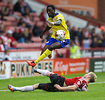Sheffield United v Crawley Town<br /> 23.8.2014<br /> Sky Bet League One<br /> Picture Shaun Flannery/Trevor Smith Photography<br /> United's Jay McEveley challenges Crawley's Bobson Bawling.