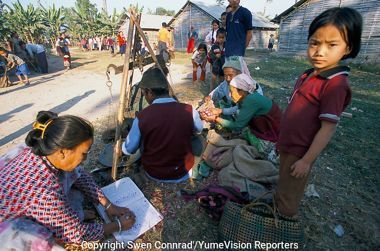 Under UNHCR protection, the life of 135000 Bhutanese refugees in one of the 7 camp near Damak, Nepal. The weekly food distribution for a Bhutanese refugee family..-The full text reportage is available on request in Word format