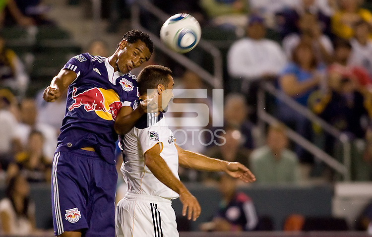 Defender Roy Miller of the New York Red Bulls goes over the top of LA Galaxy forward Jovan Kirovski for the ball. The New York Red Bulls beat the LA Galaxy 2-0 at Home Depot Center stadium in Carson, California on Friday September 24, 2010.