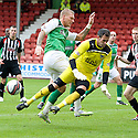 HIBERNIAN'S GARRY O'CONNOR IS BLOCKED BY PARS PAUL GALLACHER