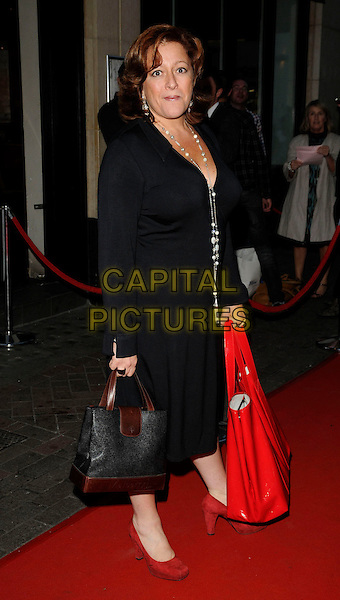 RACHEL AGNEW .at Jackie Brambles leaving party, Zebrano bar, Ganton Street, London, England 3rd August 2009.full length black dress red bag shoes .CAP/CAN.©Can Nguyen/Capital Pictures