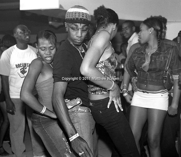 "KINGSTON, JAMAICA : Local youths dance at Kingston's hottest Dancehall nightclub "" Club Quad"". Located in New Kingston, Club Quad is a muli-level night club that hosts the best Dancehall Djs in town. Kingston, Jamaica, Eastern Caribbean."