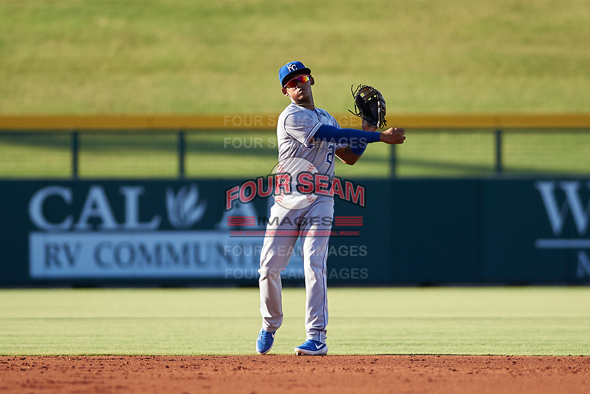 AZL Royals second baseman Herard Gonzalez (2) throws to first base during an Arizona League game against the AZL Cubs 1 on June 30, 2019 at Sloan Park in Mesa, Arizona. AZL Royals defeated the AZL Cubs 1 9-5. (Zachary Lucy/Four Seam Images)
