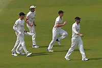 Lancashire players return the field after play is suspended for a medical emergency during Lancashire CCC vs Essex CCC, Specsavers County Championship Division 1 Cricket at Emirates Old Trafford on 11th June 2018