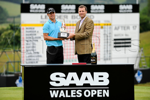 05.06.2011 Day four of the SAAB Wales Open Golf from Celtic Manor. Alexander NOREN (SWE) celebrates victory in the event with the managing director of event sponsor SAAB UK after finishing the tournament on 9 under par after the fourth and final round on the Twenty Ten course.