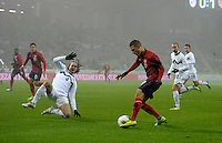 Fabian Johnson (r) of team USA, against Marko Suler (l, SLO) during the friendly match Slovenia against USA at the Stozice Stadium in Ljubljana, Slovenia on November 15th, 2011.
