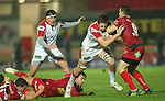 Ulster flanker Iain Henderson crashes in to Gareth Davies..Celtic League.Scarlets v Ulster.Parc y Scarlets.02.12.12..©Steve Pope