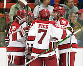 Michael Biega (Harvard - 27), Pier-Olivier Michaud (Harvard - 39), Danny Fick (Harvard - 7), (Morrison) and Brendan Rempel (Harvard - 42) celebrate Michaud's game tying goal. - The Harvard University Crimson defeated the St. Lawrence University Saints 4-3 on senior night Saturday, February 26, 2011, at Bright Hockey Center in Cambridge, Massachusetts.