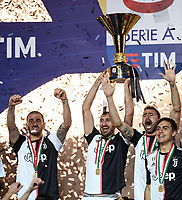 Leonardo Bonucci of Juventus , Giorgio Chiellini of Juventus , Andrea Barzagli of Juventus , Paulo Dybala of Juventus celebrate with the italian championship trophy <br /> Torino 19-05-2019 Allianz Stadium Football Serie A 2018/2019 Juventus - Atalanta  <br /> photo Matteo Gribaudi / Image Sport / Insidefoto