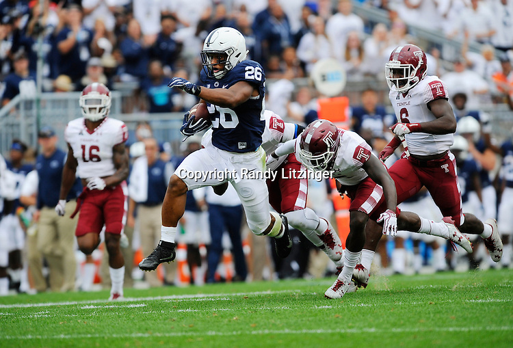 17 September 2016:  Penn State RB Saquon Barkley (26) jumps leaps during a 55-yard touchdown during the fourth quarter. The Penn State Nittany Lions defeated the Temple Owls 34-27 at Beaver Stadium in State College, PA. (Photo by Randy Litzinger/Icon Sportswire)