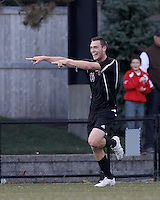 Brown University forward Ben Maurey (13) celebrates winning goal. Brown University (black) defeated Boston College (white), 1-0, at Newton Campus Field, October 16, 2012.