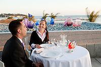 Diners on the terrace of restaurant 'Les Pêcheurs' at sunset, Cap d'Antibes Beach Hotel, Antibes, France, 26 April 2012