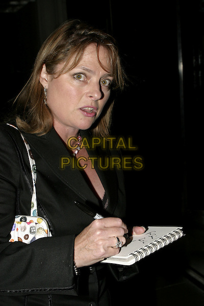 JANET ELLIS.Carol Keating Memorial Dinner, The Savoy Hotel, London, October 4th 2004..half length signing autograph funny face.Ref: AH.www.capitalpictures.com.sales@capitalpictures.com.©Capital Pictures.