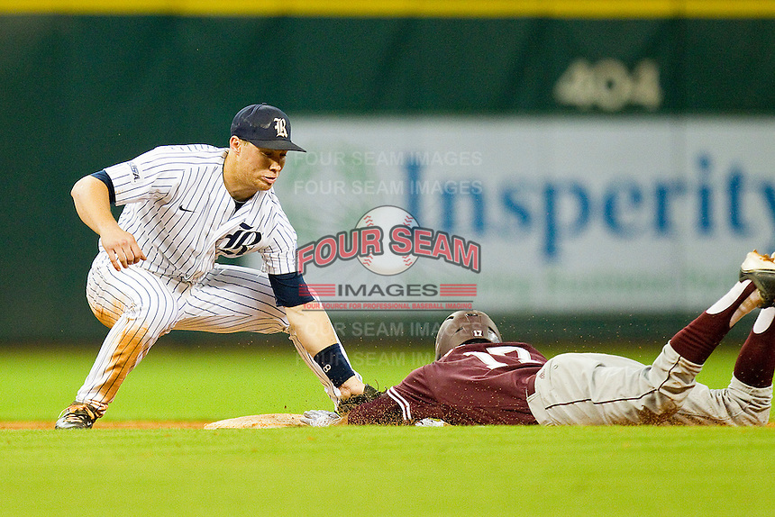 Michael Ratterree #8 of the Rice Owls applies the tag to Matt Juengel #17 of the Texas A&M Aggies as he tries to steal second base at Minute Maid Park on March 5, 2011 in Houston, Texas.  Photo by Brian Westerholt / Four Seam Images